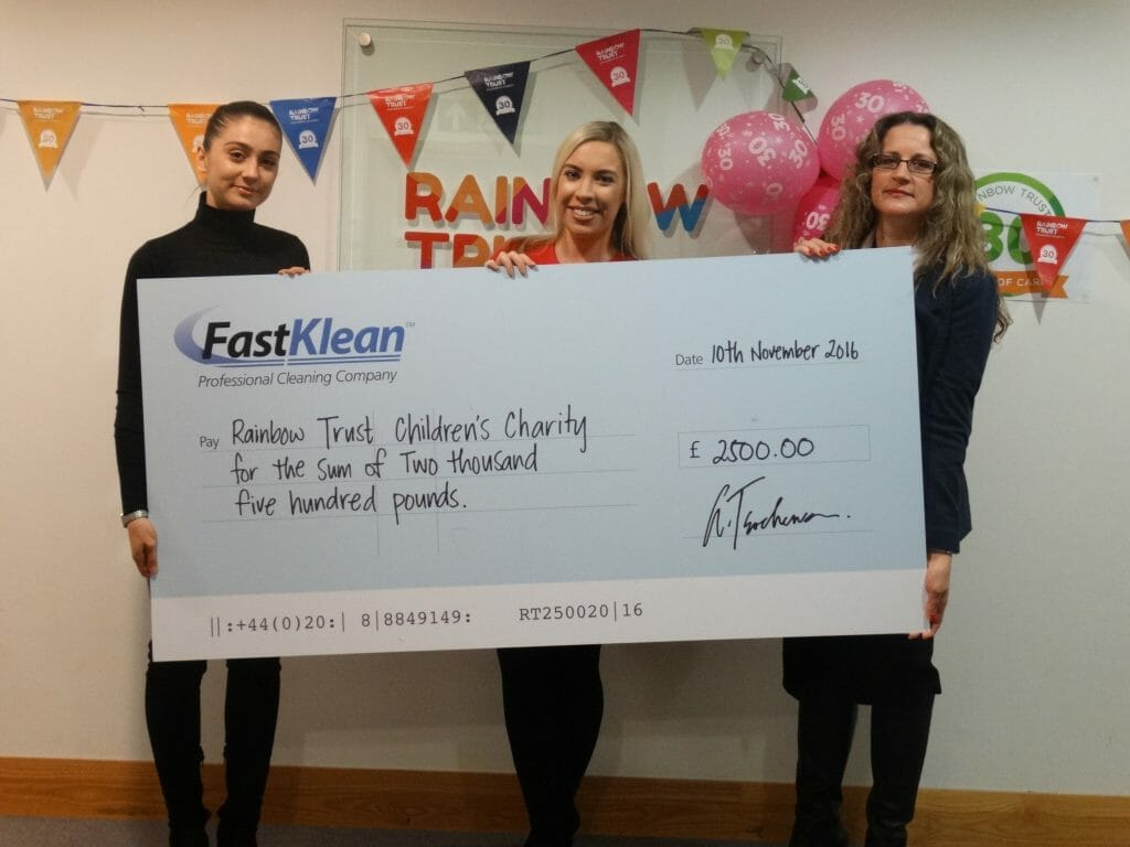 FastKlean presenting the check to Rainbow Trust